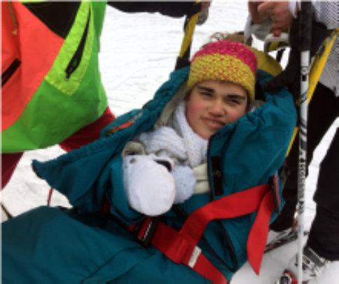 Chloe on her ski chair