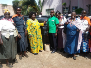 Women receive water storage tanks