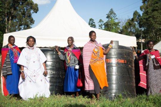 Indigenous women in Kenya receive water tanks