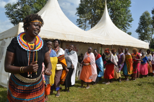 Women dance together at a MADRE-organized exchange