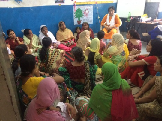 Women attending the workshop on Mahila Panchayat