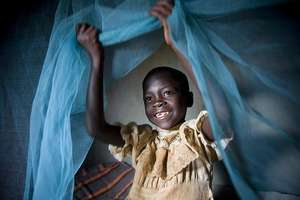 A child is protected from malaria-carrying mosquit