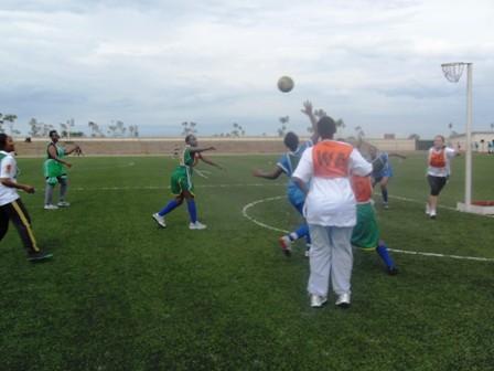 Girls and Women playing Netball