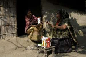 Community health promoter distributing medicines