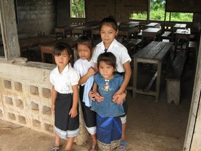 Students in front of a classroom before renovations