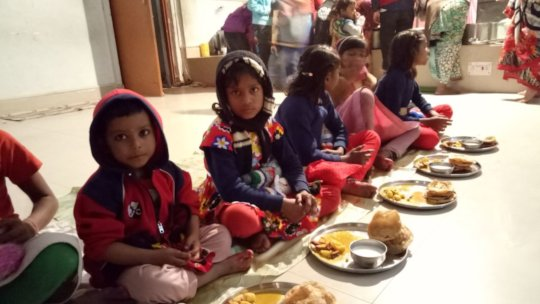 Children while having lunch on Saraswati Pooja