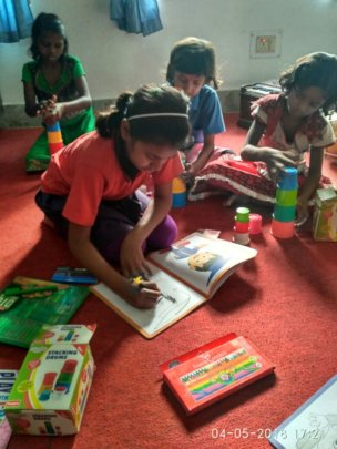 Children while doing drawing