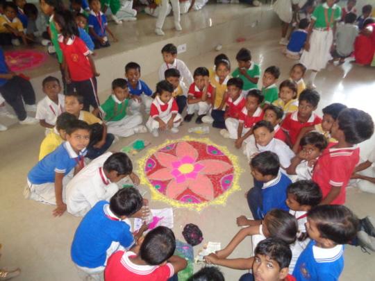 Children with Diwali Rangoli