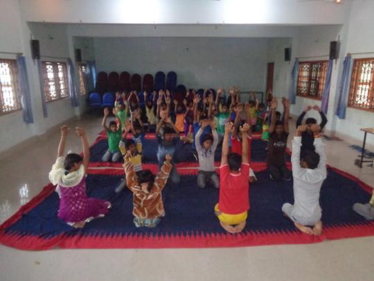 Children while doing yoga