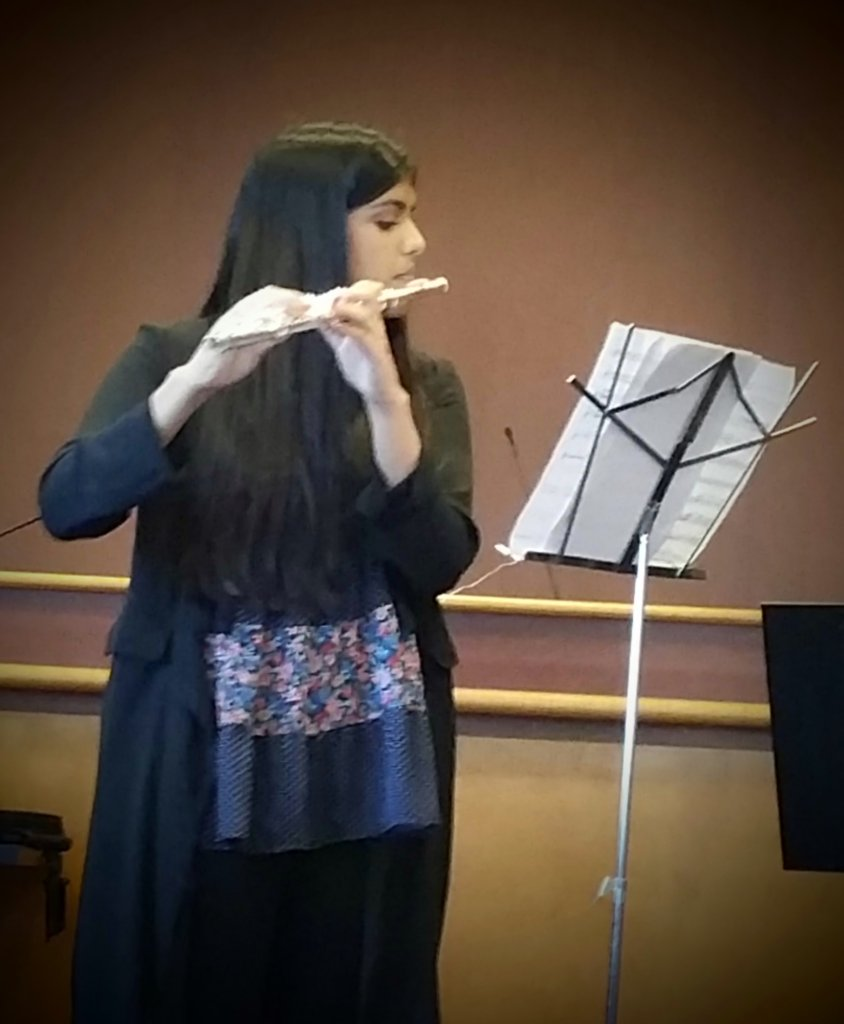 Lina performing with ensemble in Santa Clara