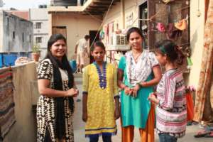 Faiza meets with the family of a GEP student