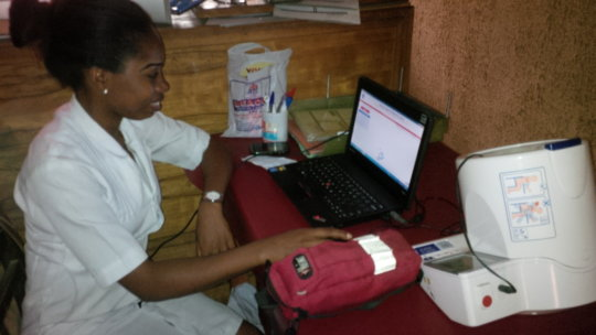 Hospital nurse with donated laptop