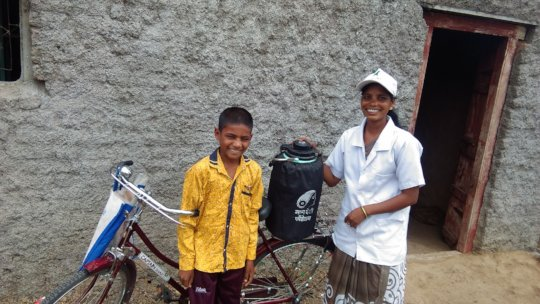 Nita on her bicycle with the nitrogen container