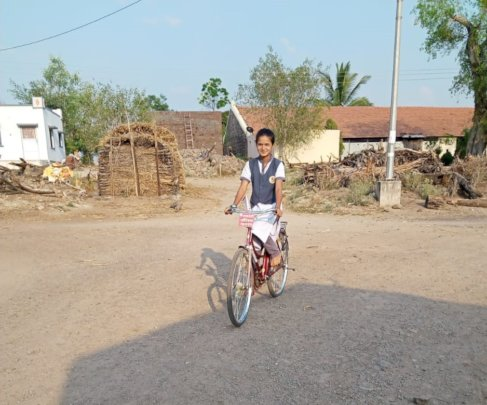 Aarti with her bicycle