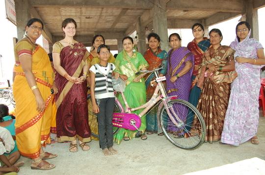 Asha with her bicycle