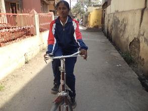 Farida rides on her bike