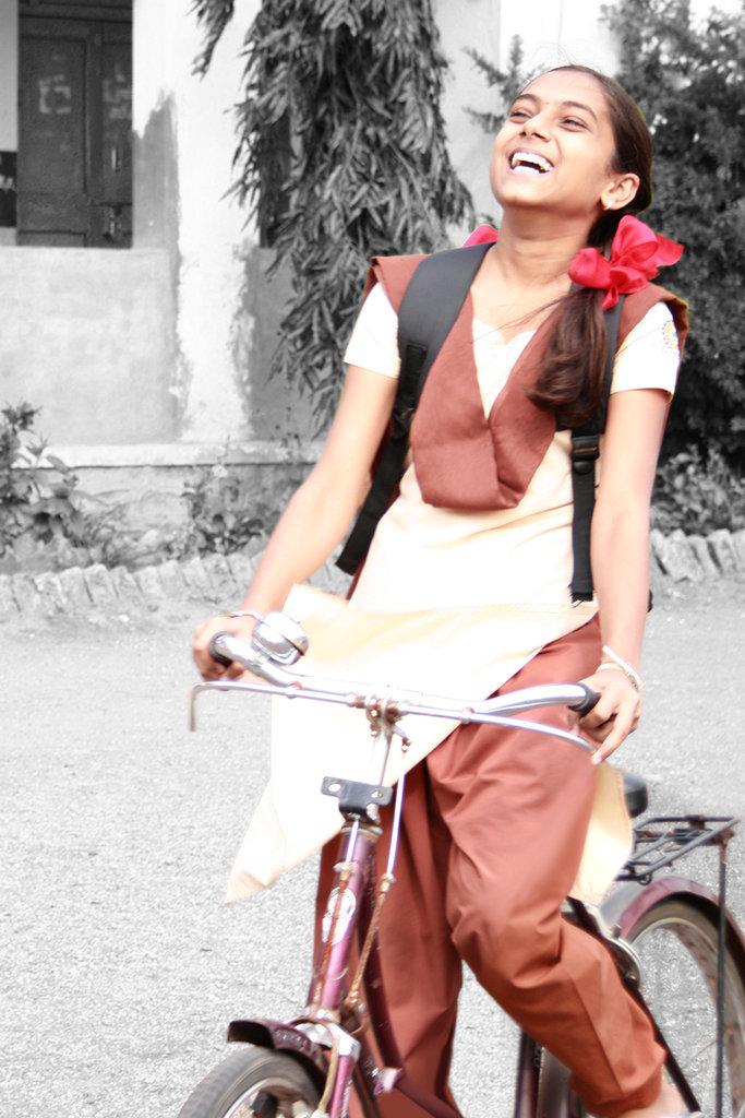 give a girl a bike: help her go to school