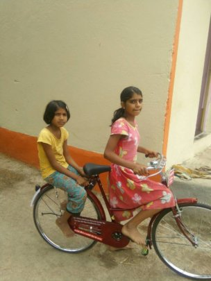 Snehal with her bicycle
