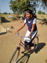 Megha with her bicycle