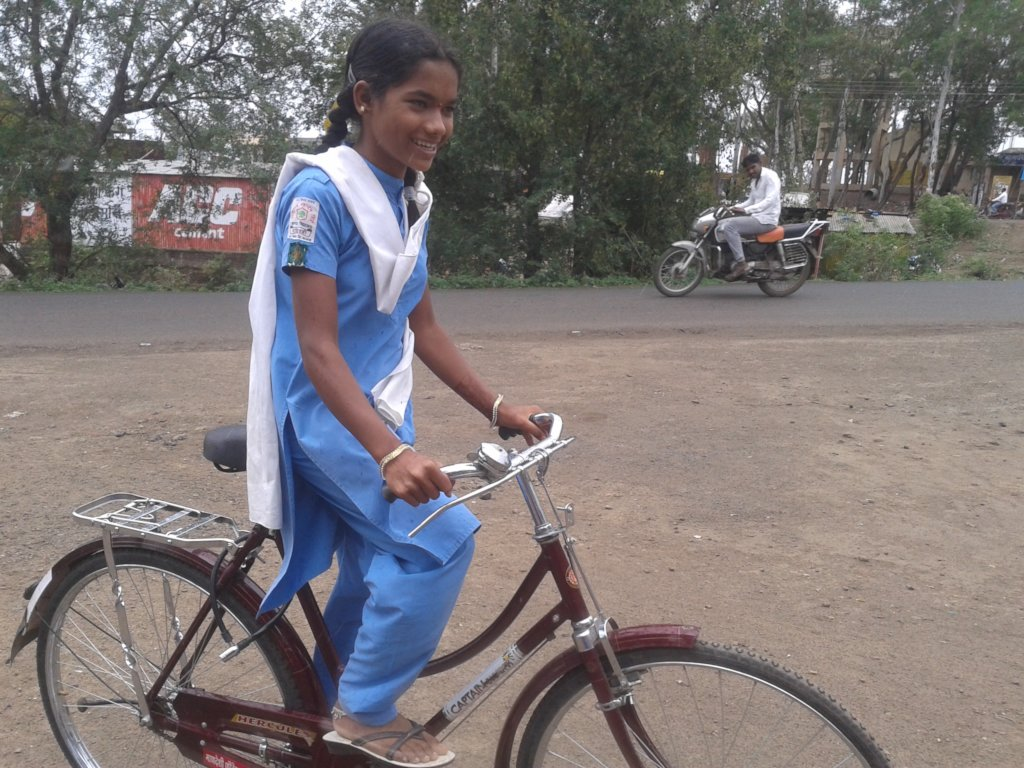 Pratiksha with her bicycle