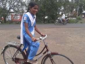 Pratiksha with her bicycle