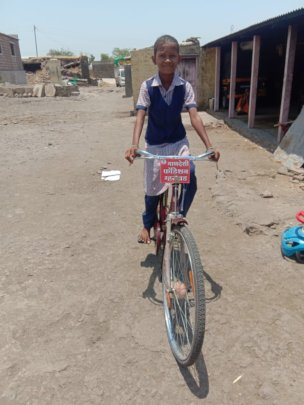 Rupali with her bicycle