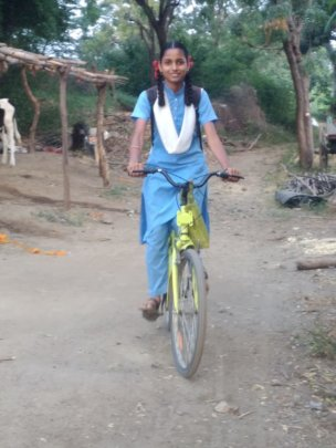 Sanika with her bicycle