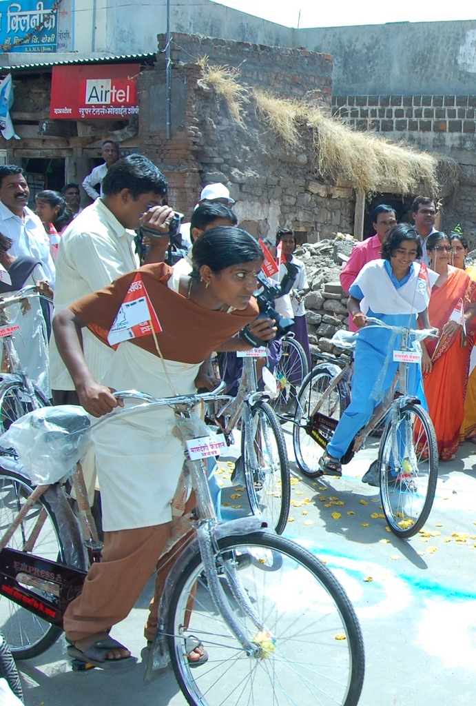School Girls Riding on Bicycles
