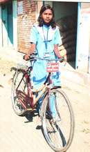 Sheetal with her bicycle