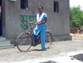 Swapnali with her Bicycle