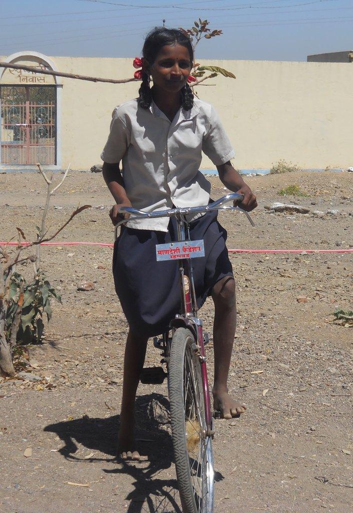 Nakusa riding on bicycle