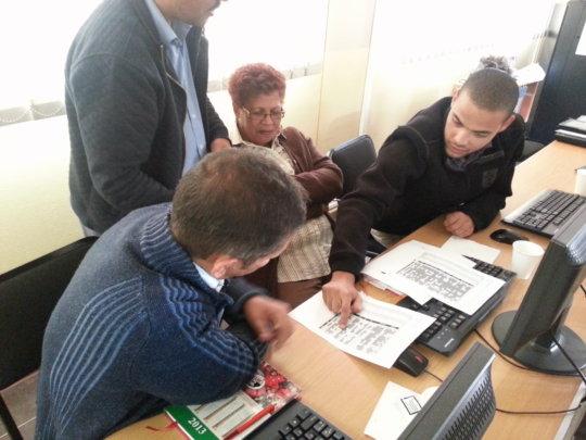 Teachers analyzing their data