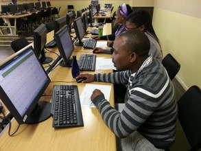 Mzamomhle teachers reviewing learners' progress