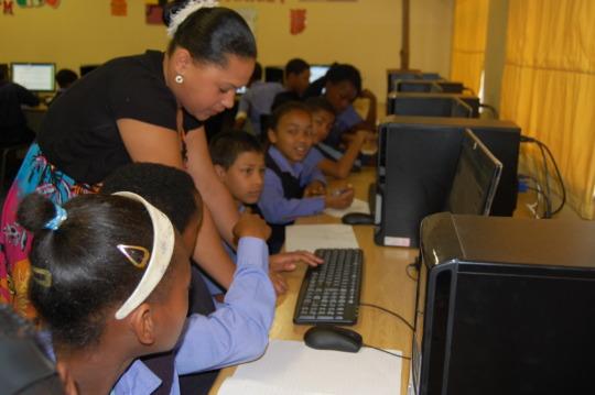 Teacher assisting learner