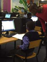 Anele assisting learners