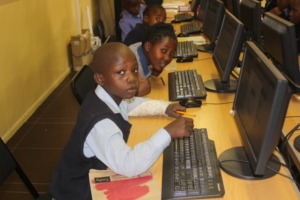Learners using ICT to do their assessments
