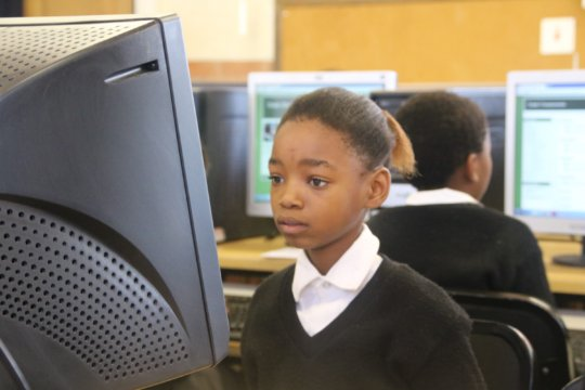 Learner completing her online Maths exercise