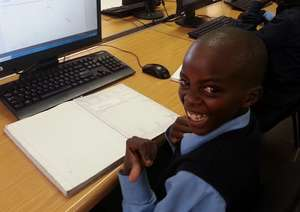 An Mzamomhle learner loving his online Maths