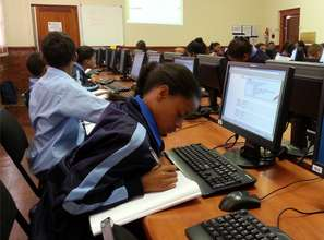 A St Mary's Primary school learner working hard