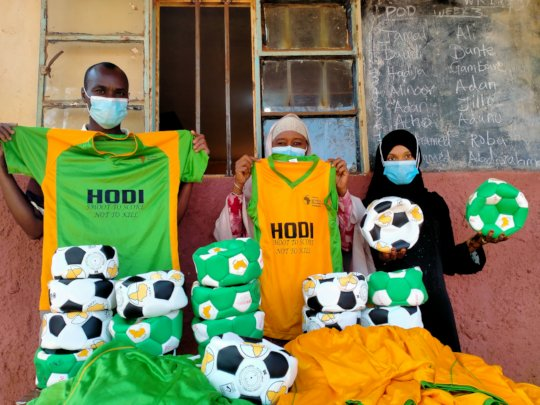 Teachers receiving balls and kit at one school