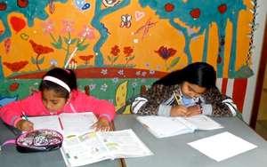Girls doing their homework at La Casa de Panchita