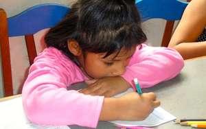 Girl doing her homework at La Casa de Panchita