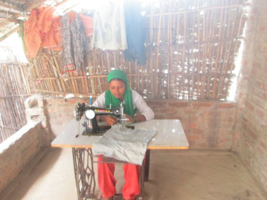 Hasina with her sewing machine