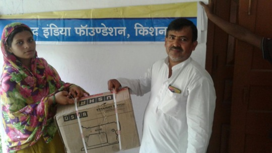 Somni receiving sewing machine from Parvez AIF