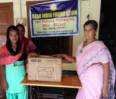 Pyari receiving her machine from AIF Chairperson