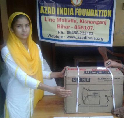 Razia with her sewing machine