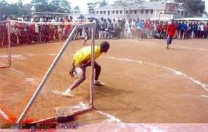 A homeless Street soccer player starts the ball