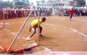 A homeless Street soccer player starts the ball