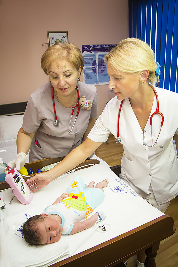 Two Nurses Screen Baby for Heart Defects