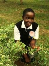 Purity enjoys spending time in the school garden.